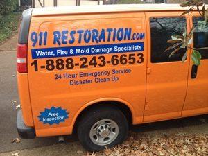 Water Damage Restoration Van At Curbside Job Location